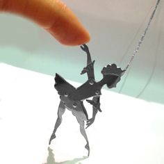 A silver ballerina marionette necklace, with moveable joints, by toosis