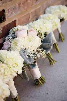 Bouquets all lined up in a row | Modern Vintage Georgia Wedding from Eclectic Exposures  Read more - http://www.stylemepretty.com/georgia-weddings/2013/08/27/modern-vintage-georgia-wedding-from-eclectic-exposures/