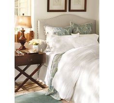 Plush bedding & an upholstered headboard for a comfortable, clean look