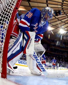 NEW YORK, NY - MAY 29: Henrik Lundqvist #30 of the New York Rangers looks on against the Tampa Bay Lightning during the second period in Game Seven of the Eastern Conference Finals during the 2015 NHL Stanley Cup Playoffs at Madison Square Garden on May 29, 2015 in New York City. (Photo by Elsa/Getty Images)