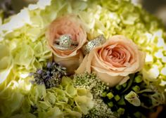Bridal Bouquet close up shot with wedding rings resting on the pale pink roses
