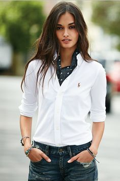An icon reinvented: Shop the new Polo Ralph Lauren women's knit oxford. Inspired by two of our classics, this cotton pique shirt combines the tailored look of an oxford with the comfort and ease of a Polo shirt. A flattering trim fit, genuine mother-of-pearl buttons and our signature multicolored pony complete the versatile look.