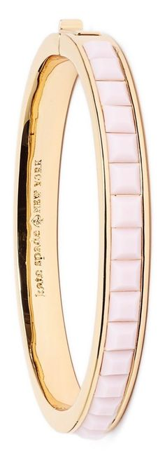 This beautiful blush and gold Kate Spade bangle is versatile enough to be worn alone or stacked and layered with other bracelets.
