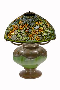 """An extremely rare American Art Nouveau """"Elaborate Rambling Rose"""" Table Lamp by, Tiffany Studios decorated with all over yellow rose decoration with an extra repeat of roses towards the lower border against a blue to blue gray background and further decorated with a heavily confetti glass background and various pieces of glass are double plated. The shade is unsigned, and the base is signed on the font """"Tiffany Studios New York circa 1905. Represented by Ophir Gallery"""