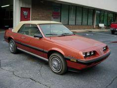I like this burnt orange/red...  1985 PONTIAC SUNBIRD CONVERTIBLE #pontiac #sunbird #windscreen http://www.windblox.com