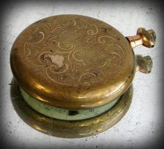 mid to late 19th century Victorian brass Modiacr pocket watch with an enamel face.