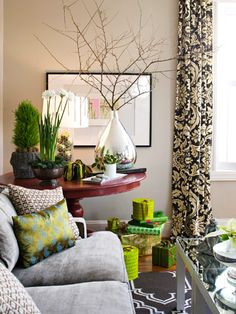 Love the huge silver vase with branches