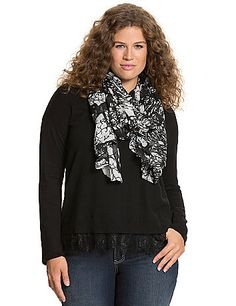 Love the layered look, but hate the bulk of extra layers? This chic and charming sweater achieves the trend in a single easy piece with a scalloped lace hem peeking out. Lightweight, fine gauge sweater is perfectly soft and versatile for dressing up or down, with ribbed trim at the scoop neck and cuffs. lanebryant.com