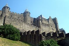 Cité de Carcassonne is a medieval citadel located in the French city of Carcassonne, in the department of Aude, Languedoc-Roussillon region. It is located on a hill on the right bank of the River Aude, in the south-east part of the city proper.