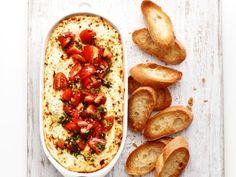 Baked Goat Cheese Dip : This dip calls for three different cheeses (goat, cream and Parmesan) along with tomatoes, balsamic vinegar and chives. Altogether, it's tart and creamy with just the right amount of tang.
