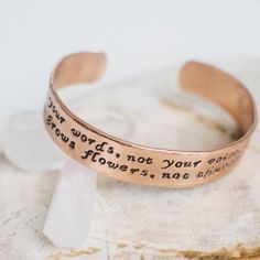 "This inspirational bracelet is a great way to make a statement on your arm and set an intention in your heart. The outside of the bracelet features the quote by Rumi, ""Raise your words, not your voice. It is rain that grows flowers, not thunder,"" with small ginkgo leaves on the ends"