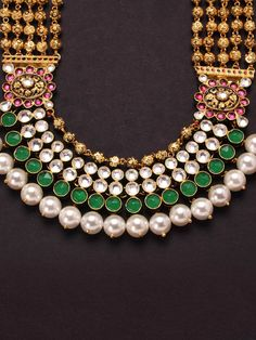White, Pink and Green Kundan Set with Pearls and golden ball string