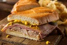 What do you do with leftover pernil (pork shoulder)? You make a Cuban-style sandwich the next day, filled with cheese, pernil, ham and mustard. Sandwich Day, Sandwich Recipes, Recetas Sandwich Cubano, Cuban Cafe, Cuban Bread, Cuban Recipes, French Recipes, Dinner Recipes, Pork Roast