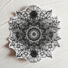 Mandala with flowers around for the eye/crown