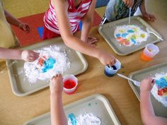 Preschool Playbook: Erupting Volcanoes!  Tray of baking soda.  Vinegar with food coloring.  Eye droppers.