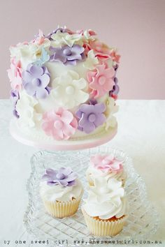 cute pink, purple/lavender and white cake