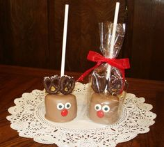 Chocolate covered Marshmallow Reindeer.  Marshmallows dipped in milk chocolate, pretzel antlers are dipped in dark chocolate, candy eyes and m-&-m nose.  (Tip:  Place marshmallows in fridge to get them cold before dipping them in the melted chocolate)