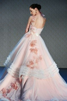 Stunning pink wedding gown with lovely flowers on skirt
