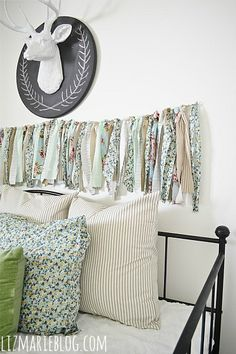 diy fabric garland, crafts, The DIY fabric garland hangs above our day bed in the guest bedroom Diy Fabric Headboard, Diy Headboards, The Chic Site, Recycling, Fabric Garland, Ribbon Garland, Inspiration Design, Diy Arts And Crafts, Fabric Scraps