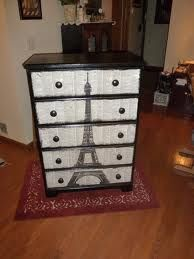 love the eiffel tower on a dresser! would be cute for a world themed room!