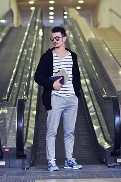 This combination of a black shawl cardigan and grey chinos is perfect for a night out or smart-casual occasions. Blue camo trainers will contrast beautifully against the rest of the look.  Shop this look for $212:  http://lookastic.com/men/looks/shawl-cardigan-and-v-neck-t-shirt-and-zip-pouch-and-chinos-and-athletic-shoes/2852  — Black Shawl Cardigan  — White and Black Horizontal Striped V-neck T-shirt  — Navy Leather Zip Pouch  — Grey Chinos  — Blue Camouflage Athletic Shoes