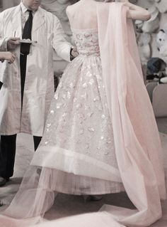 Detail of Christian Dior preparing for a show by...