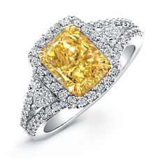 Natalie K Design no. NK20895FY-WY A center cushion-cut fancy yellow diamond center sits surrounded by brilliant round diamonds and pear-shaped diamonds in this fancy yellow diamond engagement ring. #wedding