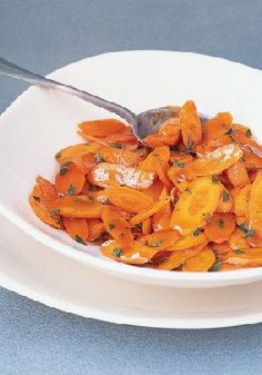 Sweet Glazed Carrots -- This healthy living recipe will be the first side dish on the dinner table! It's ready in just 20 minutes, and all of your guests are sure to enjoy it.