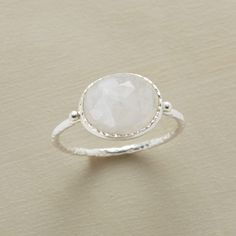 SILVER LINING MOONSTONE RING -- A portrait of rainbow moonstone's clear-to-cloudy landscape. Textured rim and band