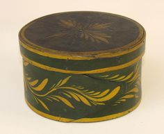 "Paint-decorated round pantry box Probably Massachusetts, circa 1840 Maple and pine, original painted decoration, height 2 3/4 inches, diameter 5 inches.   Branded ""IA"" on underside. www.fairfieldauction.com"