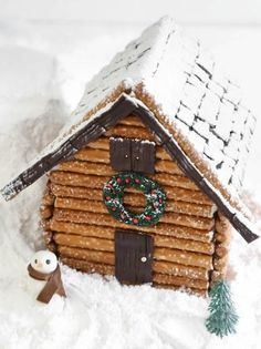 Gingerbread House With Chocolate Fondant and Pretzel Rods