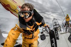 "April 1, 2015. Leg 5 to Itajai onboard Abu Dhabi Ocean Racing. Day 14.  Luke ""Parko"" Parkinson adjusts the daggerboard in the pit wearing goggles to protect his eyes from the blinding spray"
