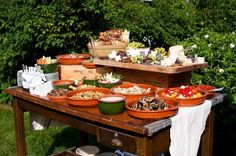 layer the table with overturned vintage box supporting a board with charcuterie