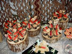 We used various heights of wood pieces for cupcake stands. Cupcakes are each topped with a real shotgun shell (washed of course).  :) Rhyder's 1st birthday party was a success.  Complete with a skeet shoot and camo wearing friends and family!  :)