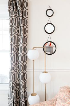 """A funky, modern """"Cosmos Floor Lamp"""" from Land of Nod."""