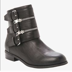 Black faux leather ankle boots with zippers Super cute ankle boots with zippers on the side. They have a very slight heel to them. I bought them on posh and only wore them once. They are in great condition. No visible wear. If you have any questions feel free to ask or make an offer torrid Shoes Ankle Boots & Booties