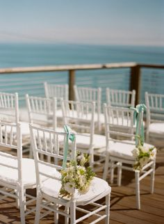 a seaside ceremony overlooking the water |  Photography by esthersunphoto.com, Florals by http://www.pixiespetals.com,   Read more - http://www.stylemepretty.com/2013/09/23/laguna-beach-wedding-from-esther-sun/