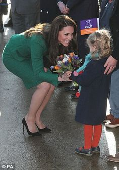 Youngsters from three local primary schools came out to welcome Kate, waving flags in EACH...