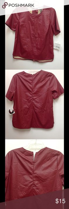 ❤️❤️Red Faux Leather Shirt❤️❤️ Cute Short sleeve red shirt, 100% polyester shirt. Hidden zipper in the back. Feels like butter soft leather. Made for Impulse Tops Blouses