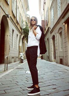 White. Black. Sneakers. Cool. Woman.