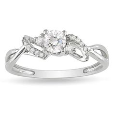 Ask for her hand with this lovely Miadora 10-karat white gold engagement ring. The beautiful round center-cut diamond is accented by loop detailing and 18 round-cut, white diamonds to create a look th