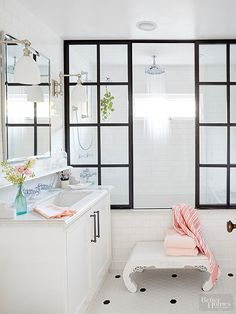 Even the tiniest of baths demand spotlight-worthy style. Make a statement in a small white bath with a single unexpected feature. The homeowner splurged on this custom metal shower door to achieve the look of old factory windows.