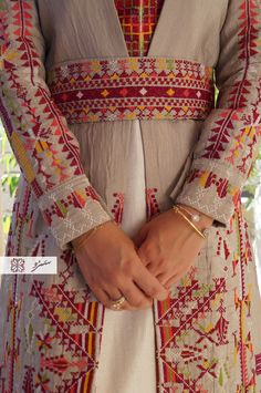Items similar to Khan Younis colorful dress - Thoub / cross stitch traditional handmade Palestinian embroidery dress / wedding dress, caftan, belt and dress on Etsy Phulkari Embroidery, Hand Embroidery Dress, Indian Embroidery, Hand Embroidery Designs, Floral Embroidery, Cross Stitch Embroidery, Embroidery Patterns, Stitch Patterns, Dress Design Sketches