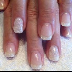 White iridescent glitter french with full glitter ring nails