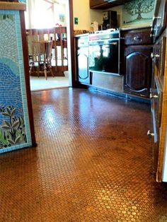 Like the look of copper? So did mosaic artist Amanda Edwards, who decided to cover her kitchen floor entirely in pennies. One year and 31,140 pennies later, the project was complete. Edwards glued each penny individually, then finished with black sanded grout and 3 coats of polyurethane floor sealant.
