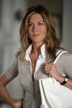 """Jennifer Aniston in """"The Breakup"""". Classic collard shirt with a buttoned up cardigan. Neutral colors look nice."""