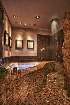 A mozaikcsempe és a kőburkolat keveréke, a trópusi zuhany és a sarokba épített egyedi kád és a hangulatfények romantikussá teszi ezt a fürdőszobát. Ezt igazán megnézném a valóságban is, nemcsak számítógépen 3D-ben :)