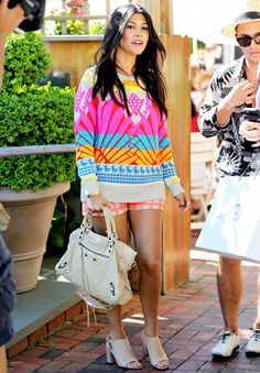 Kourtney Kardashian wears a neon ensemble (covering her baby bump!) while filming Kourtney and Khloe Take the Hamptons on June 6