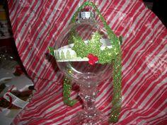 Flat glass ball ornament w/glitter tape, card board holly leaf embellishment and ribbon