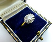 A delightful Antique diamond cluster ring from the Art Deco Era circa 1930s...... This lovely diamond ring with its unusual design shows fine